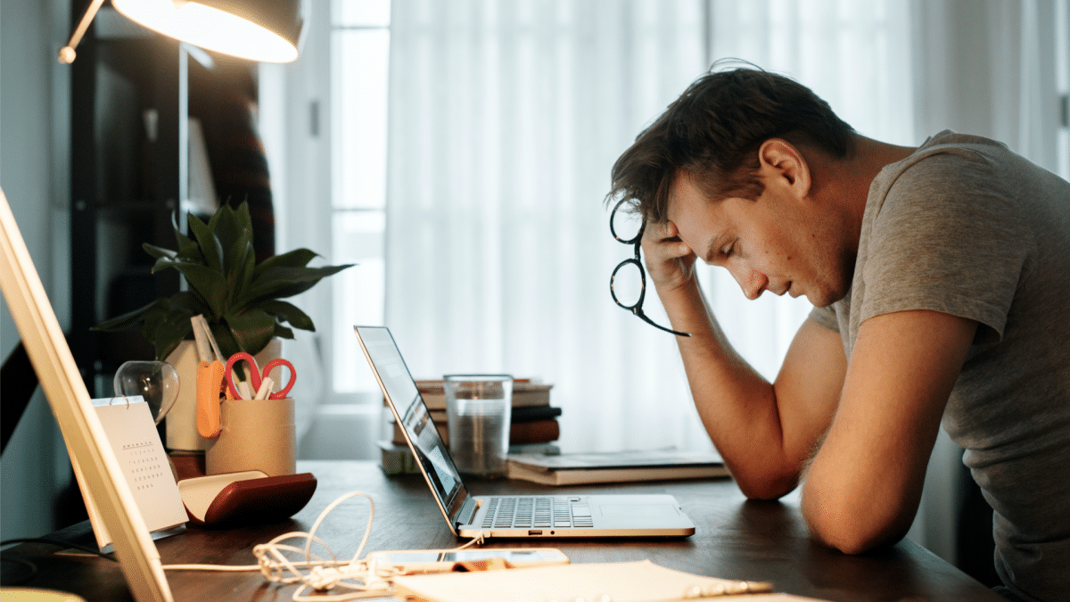 man looking at laptop stressed