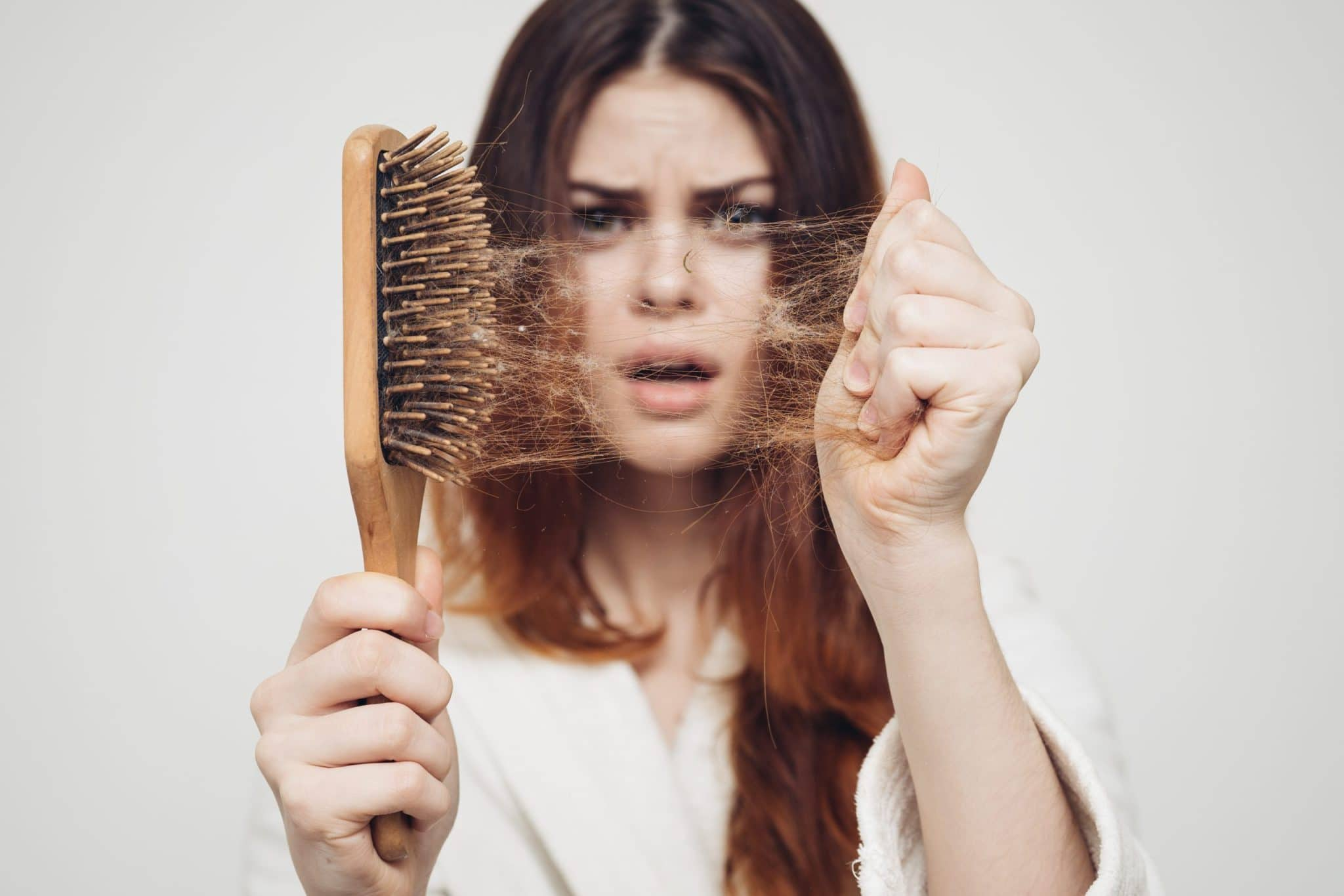 girl with a comb pulling out hair